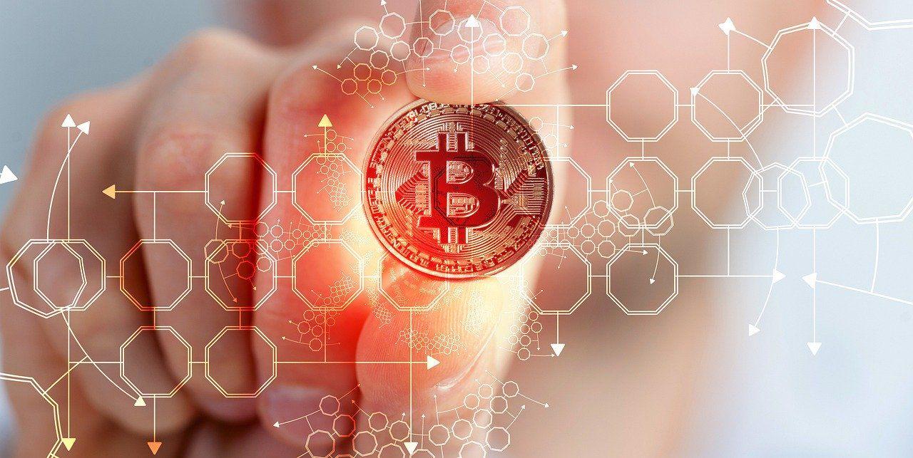 Bitcoin Kurs Prognose Bitcoin MÜnze in Hand
